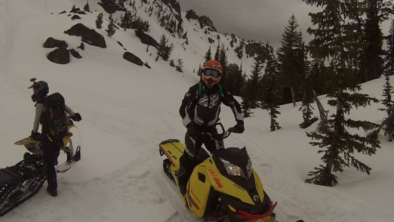 Climbing The Lakes Lookout Saddle on Snowmobiles 5-15-2017